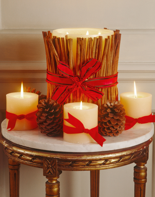 christmas-centerpieces-pillar-candles-red-ribbons-cinnamon-sticks